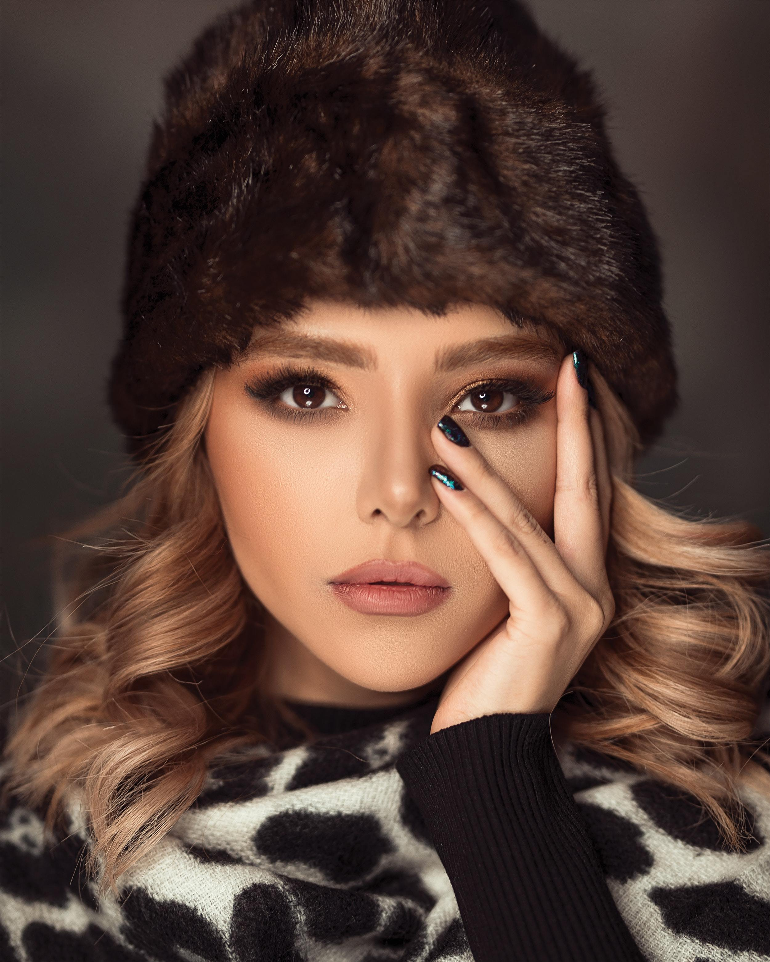 blonde lady in faux fur hat, animal print shawl and natural coloured make up